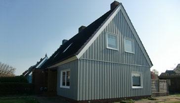 altes Finnenhaus mit neuer Holzverkleidung